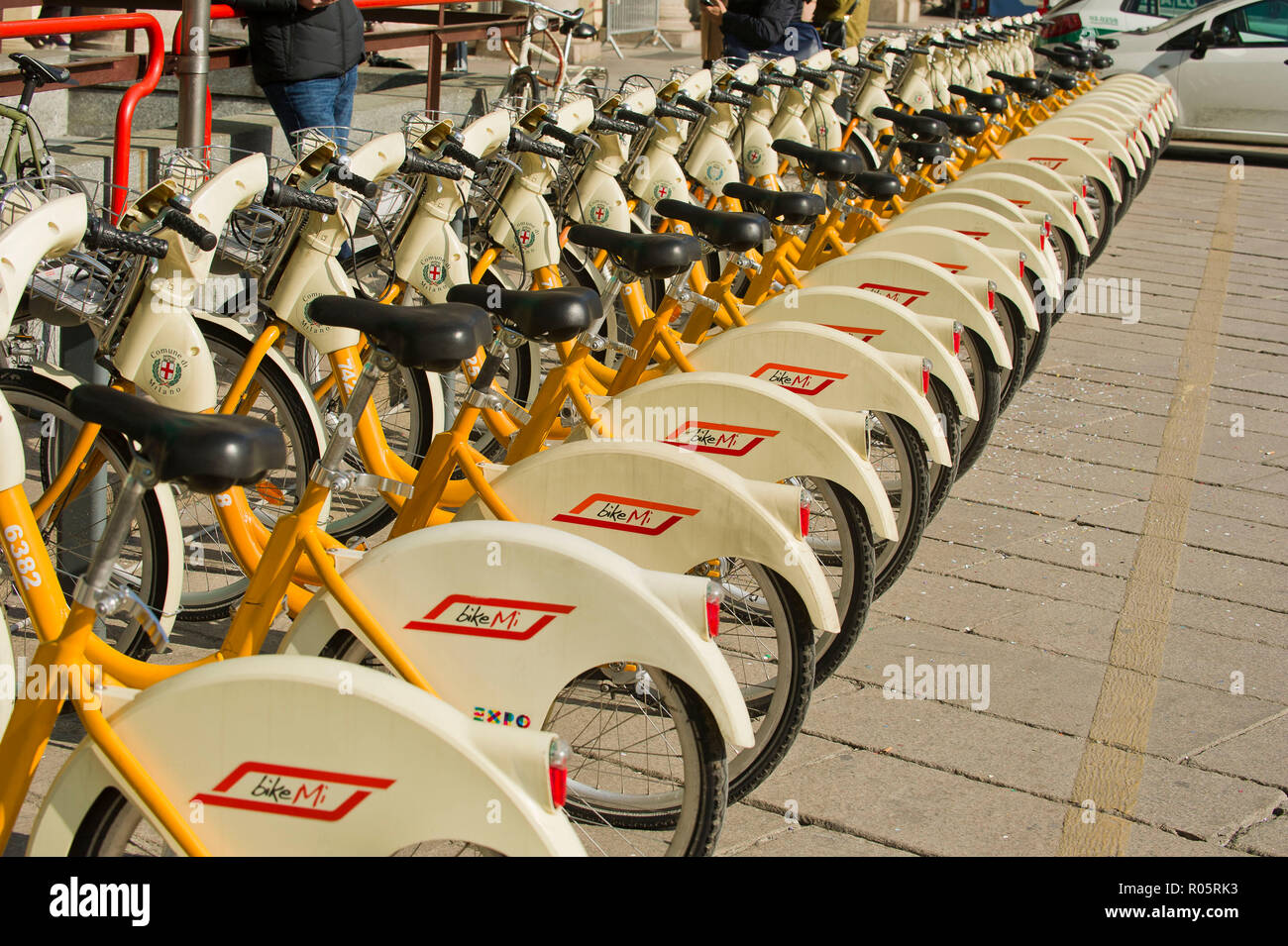 Italy, Lombardy, Milan, bike sharing in Duomo Square - Stock Image