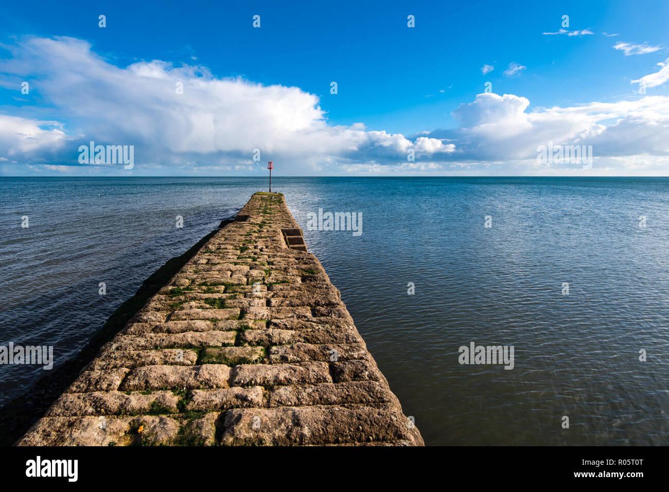Stone jetty at Dawlish, Devon,UK - Stock Image