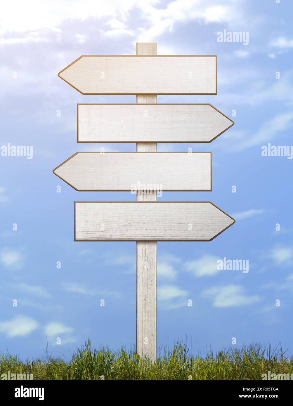 old signpost white direction decision in summer - Stock Image