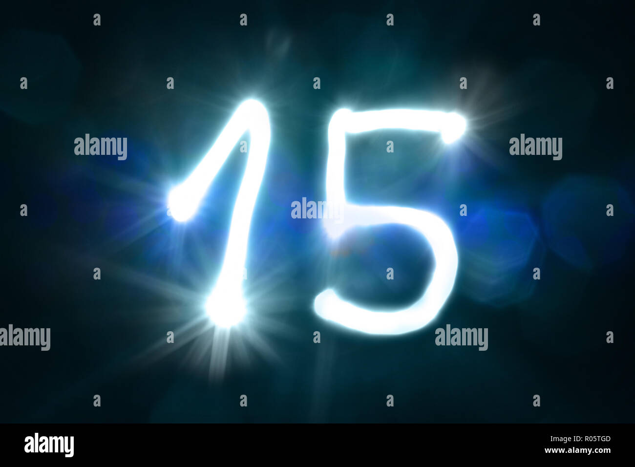 fifteen light sparkle shine number anniversary year - Stock Image