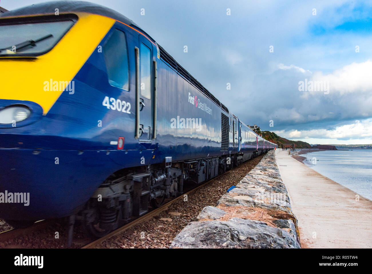 DAWLISH, DEVON, UK - 26OCT2018: GWR Class 43 High Speed Train 43022 travelling south along the sea wall at from Dawlish. - Stock Image