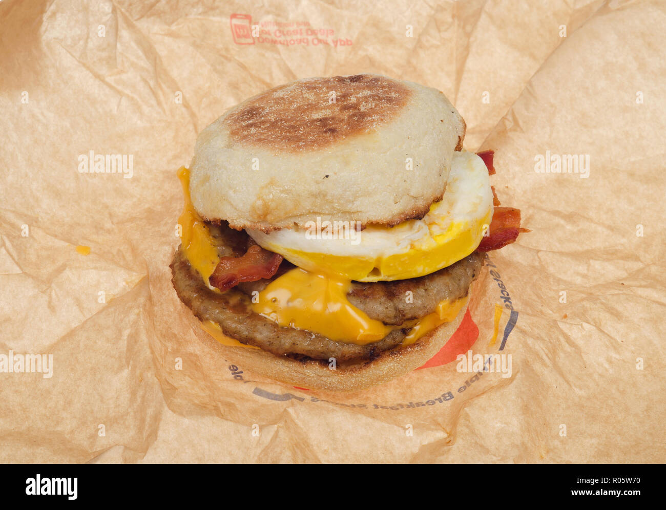 McDonald's new breakfast sandwich, the Triple Stack with 2 sausage patties, 2 slices american cheese, 2 strips of bacon, an egg on an english muffin - Stock Image