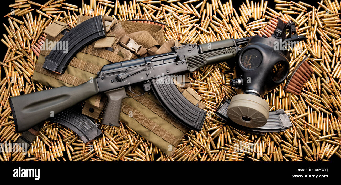 Assault rifle weapon and live ammunition - Stock Image