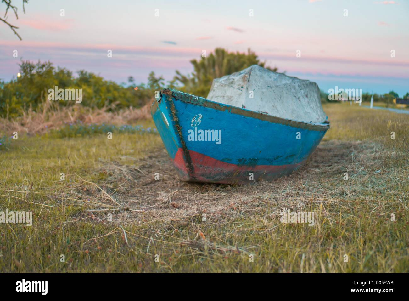Two wooden boats abandoned in the middle of nature - Stock Image