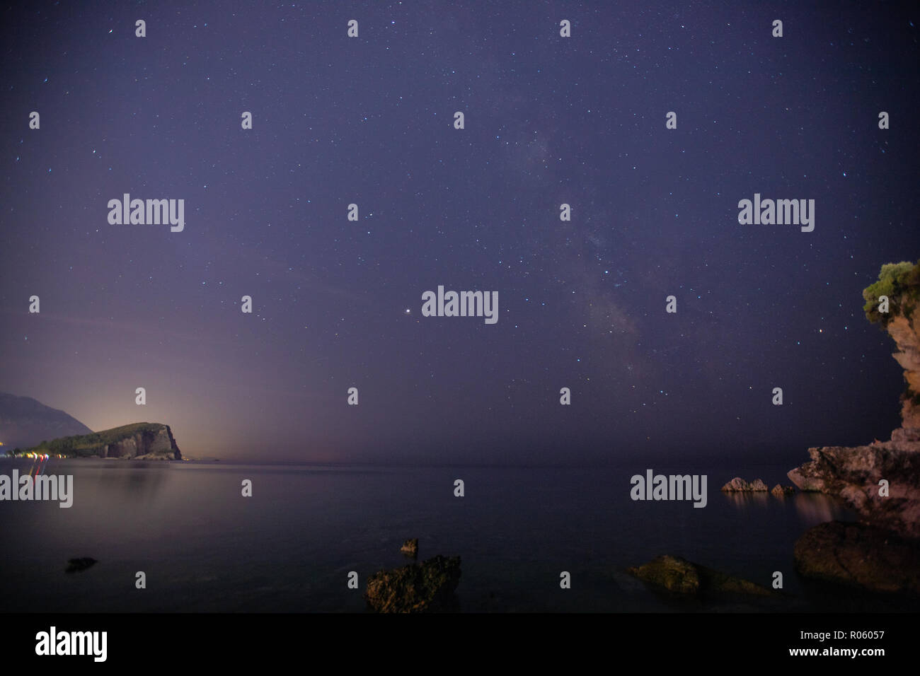 Night sky with stars and Milky Way above the sea. Montenegro - Stock Image