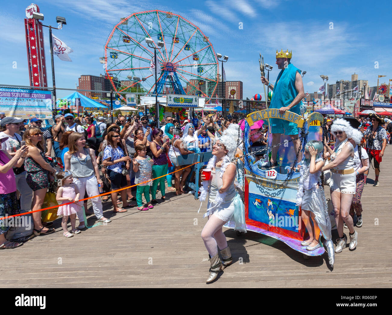 People having fun watching the Annual Mermaid Parade at Coney Island, Brooklyn, New York. - Stock Image