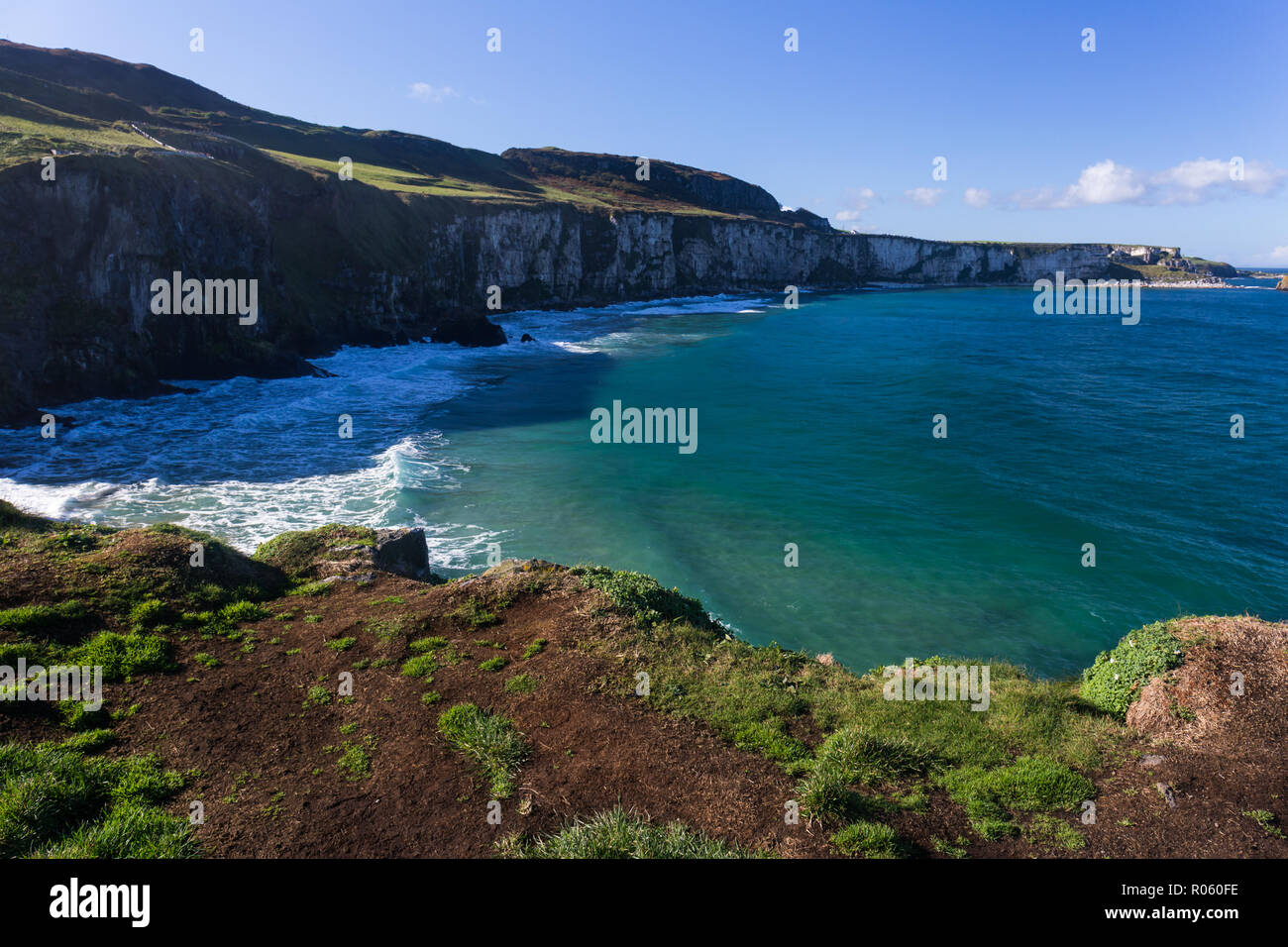 View of North Antrim coastline looking West from Carrick-a-Rede island. County Antrim, N.Ireland. - Stock Image