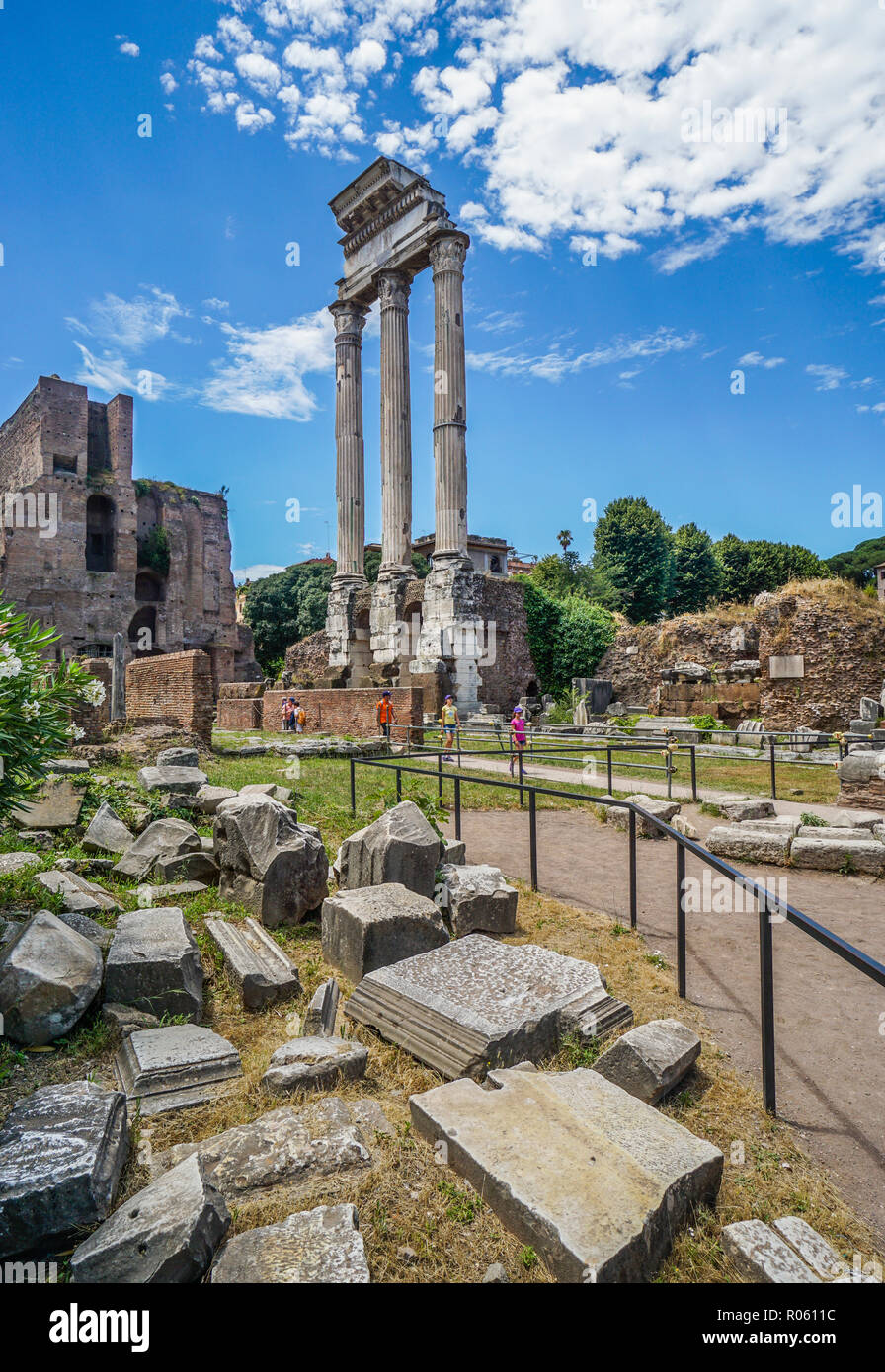 the three remaining Corinthian columns of the ruins of the Temple of Castor and Pollux at the Roman Forum, Rome, Italy - Stock Image