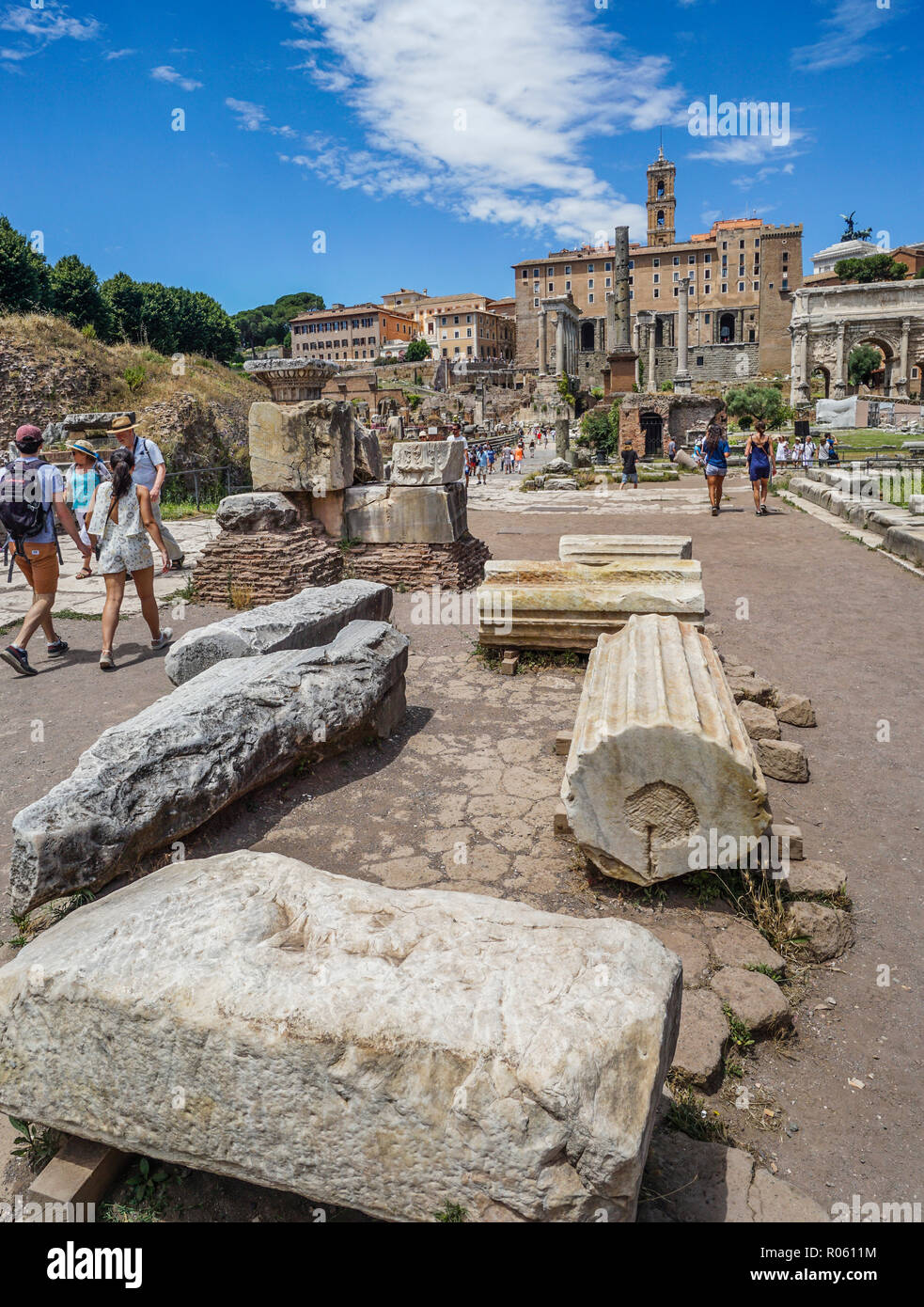 fragmented columns of the ruins of the Roman Forum at the Via Sacra, Rome, Italy - Stock Image