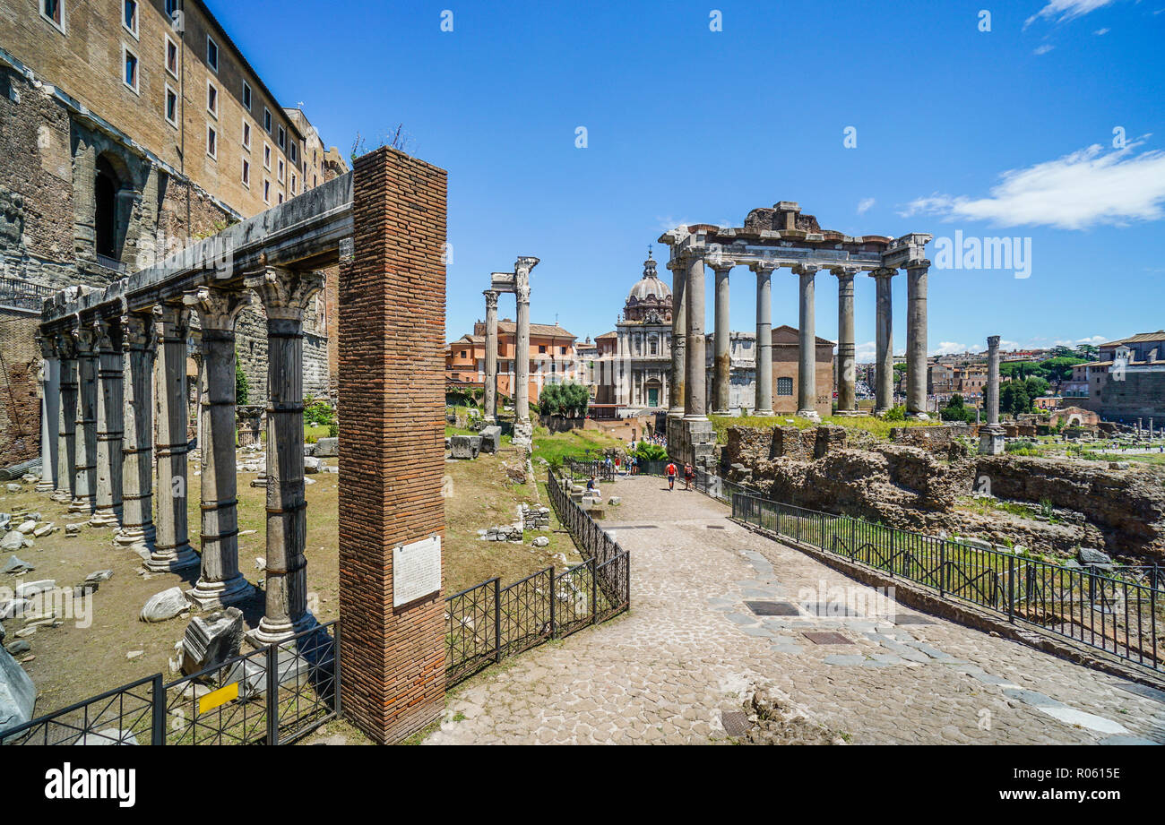 Porticus Deorum Consentium, the Portico of the Harmonious Gods ancient structure next to the Temple of Saturn at the Roman Forum, the ancient city of  - Stock Image
