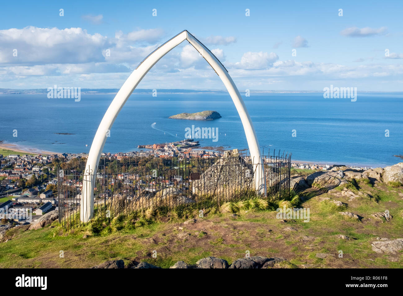 Top of North Berwick Law, on sunny day, view through whale's jaw bone out to Bass Rock and the Firth of Forth, North Berwick, East Lothian, Scotland, Stock Photo