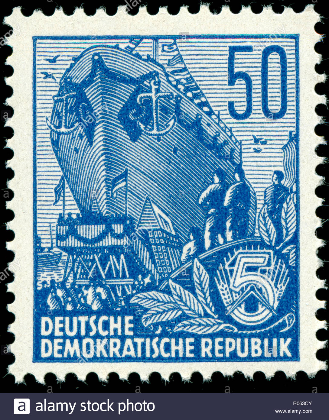 Old stamp from the East Germany in the Five-year Plan series - Stock Image