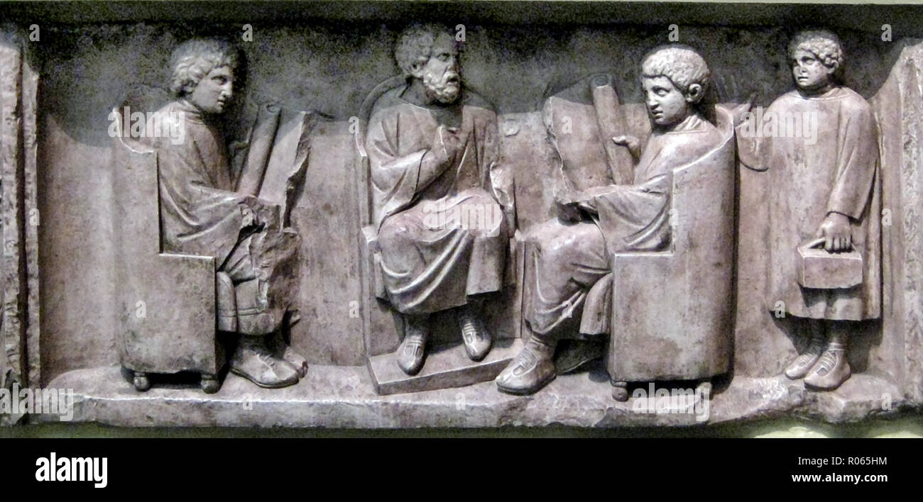 6388. Roman school, teacher (seated in centre) and pupils, stone relief, c. 2nd. C AD. - Stock Image