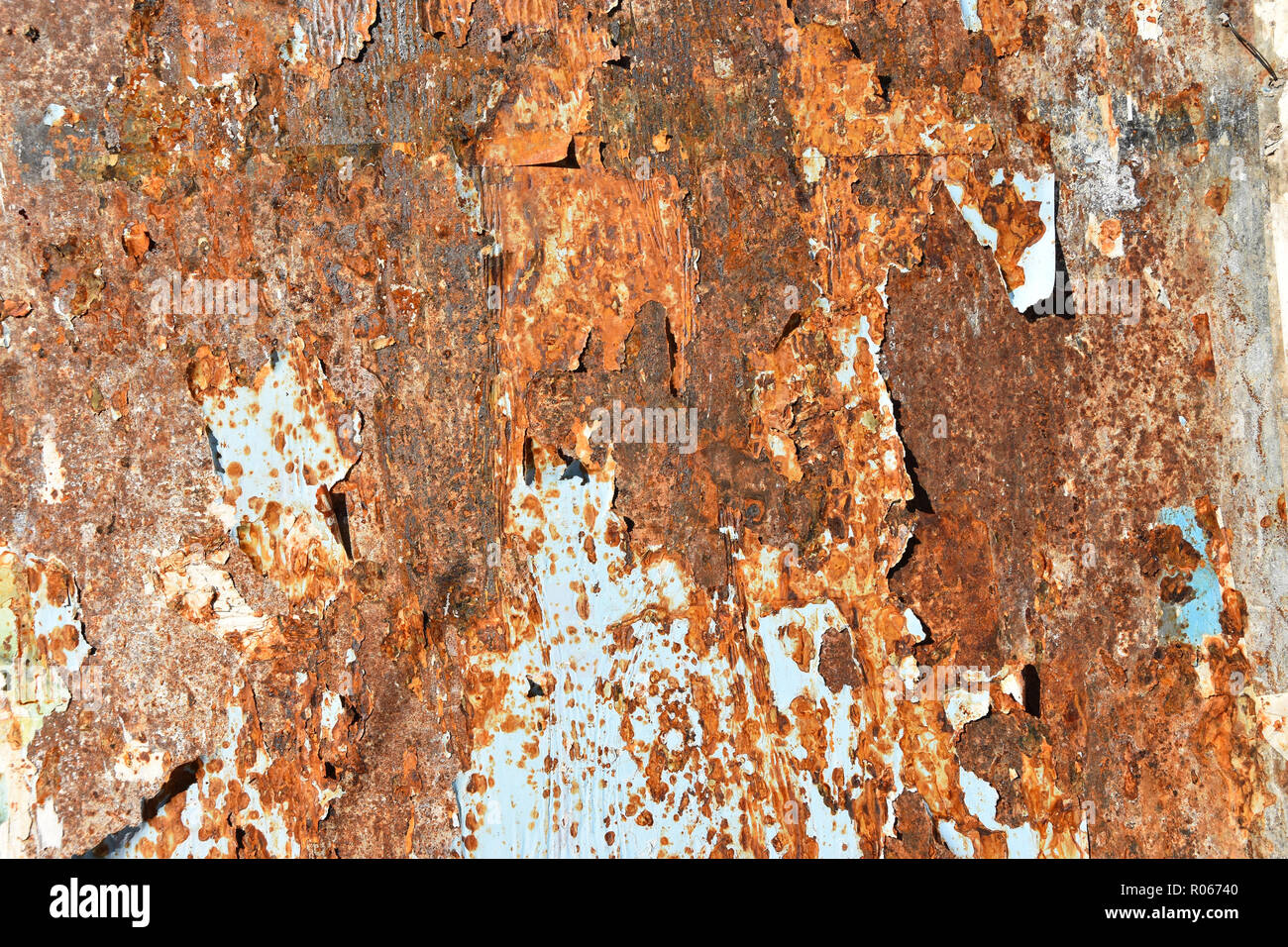 corroded sheet metal background with remains of posters Stock Photo