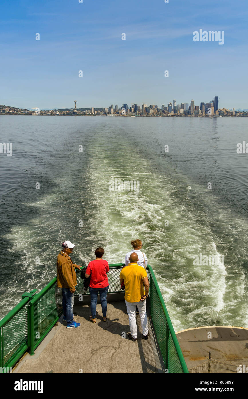 EN ROUTE SEATTLE TO BREMERTON - JUNE 2018: People standing on a platform on the back of a passenger ferry from Seattle to Bremerton. Stock Photo