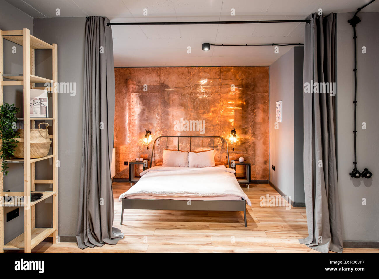 . Modern loft bedroom interior with wall made of copper metal  Real