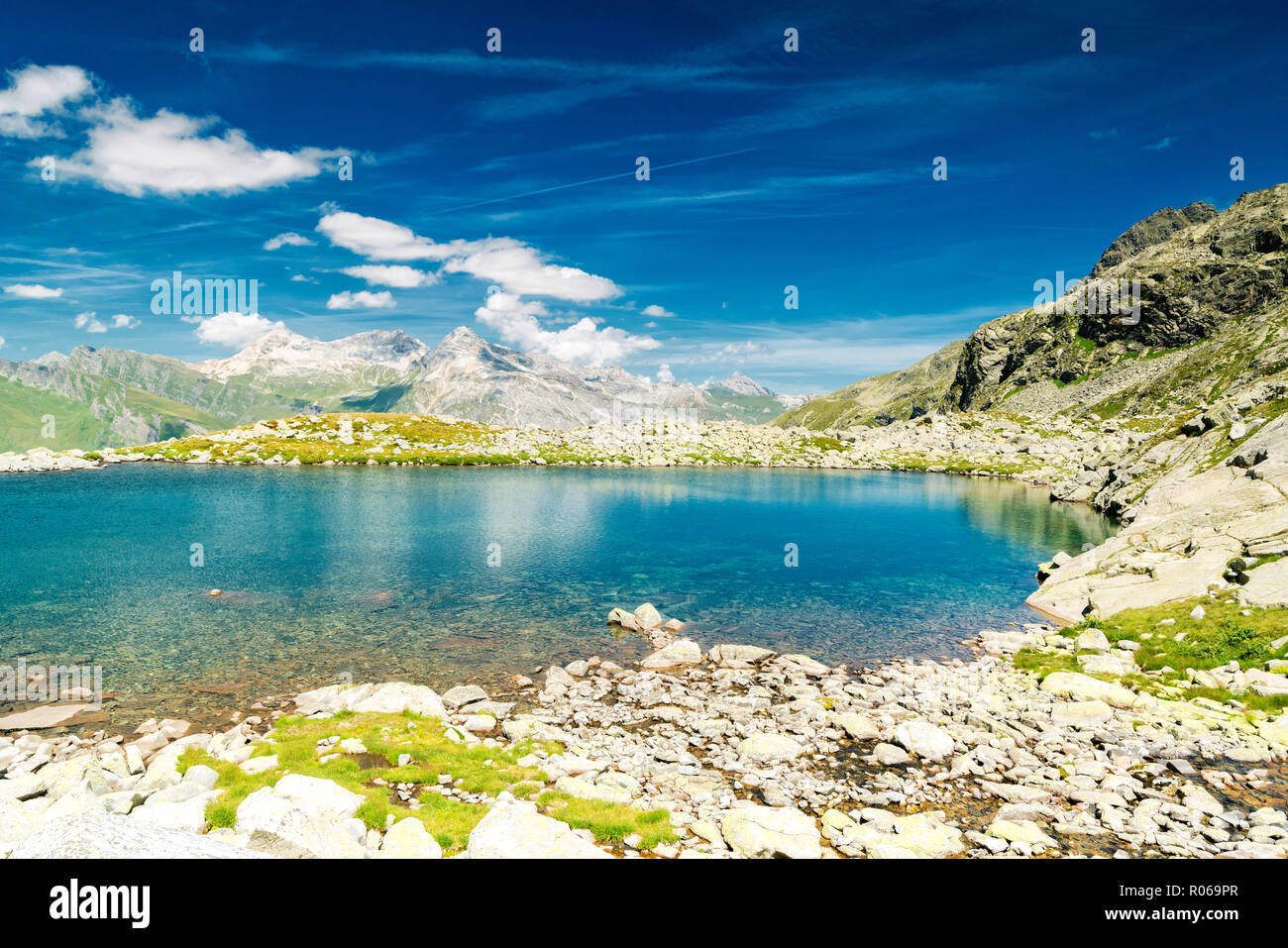 Turquoise crystalline water of lake Bergsee, Spluga Pass, canton of Graubunden, Switzerland, Europe - Stock Image
