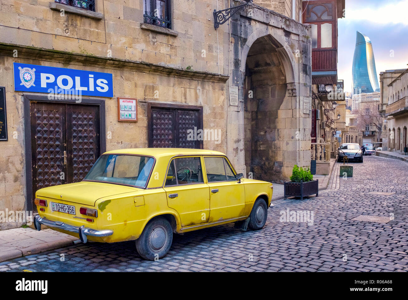 Old yellow soviet car (Moskvitch) in Icheri Sheher (Old City), Baku, Azerbaijan - Stock Image