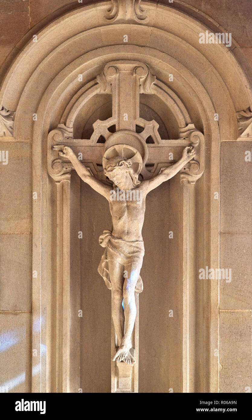 Stone carving (of the crucifixion of Jesus) on a wall of the Chapel of All Souls in the tudor medieval chapel of King's college, university of Cambrid - Stock Image