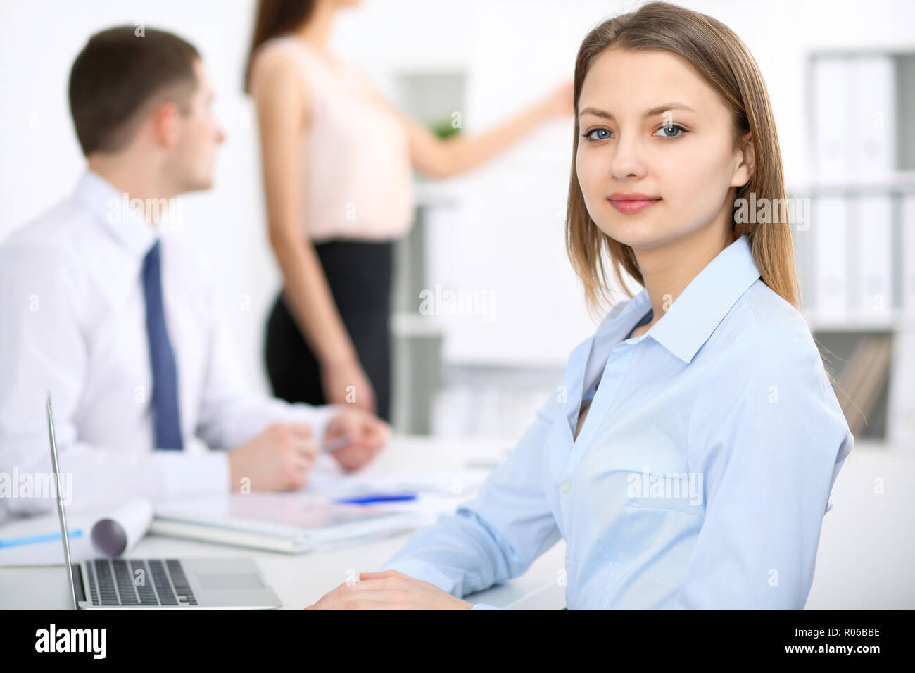 Portrait of a young business woman  at meeting. Negotiation concept - Stock Image
