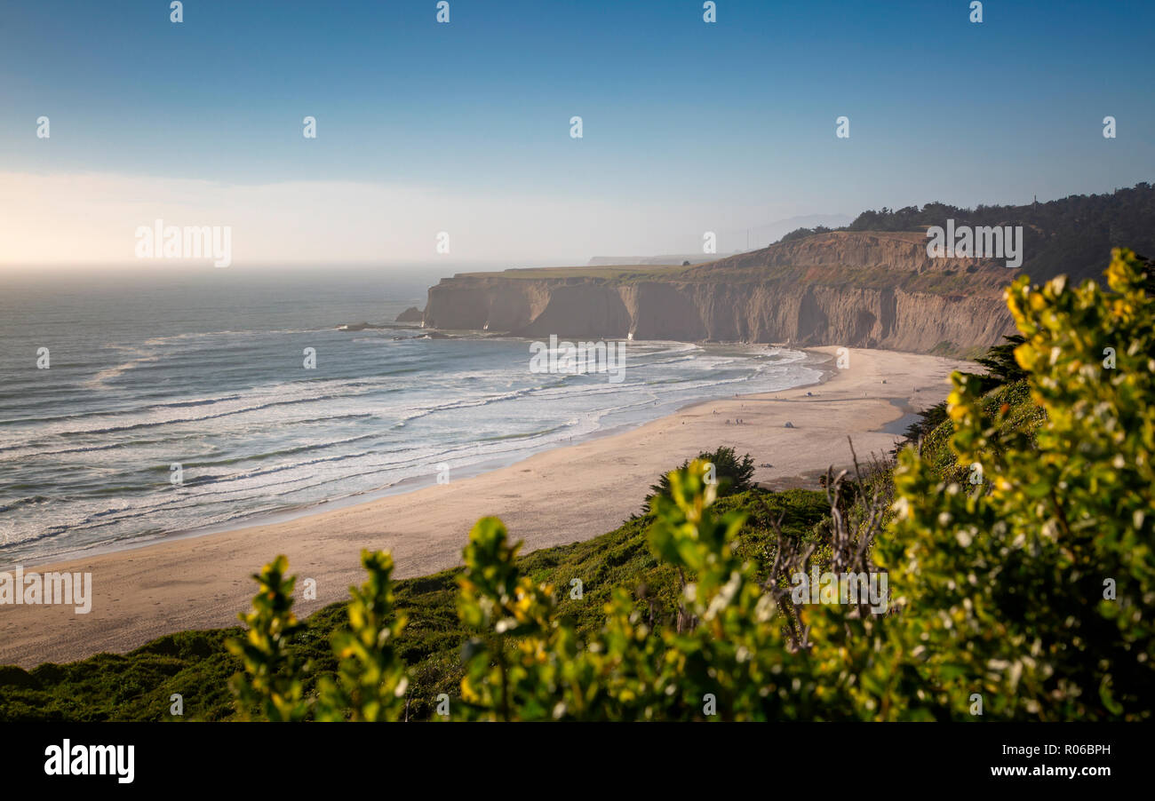 View of beach and cliffs on Highway 1 near Davenport, California, United States of America, North America - Stock Image