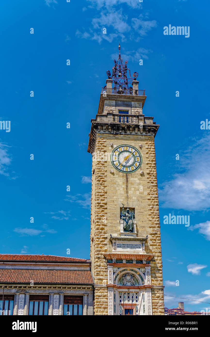 Day view of Torre dei Caduti with clock, 1924 historic stone Tower of The Fallen, at Piazza Vittorio Veneto, Bergamo, Lombardy, Italy, Europe - Stock Image