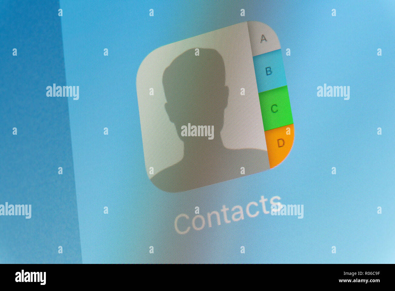Apple Contacts App on cellphone screen - Stock Image