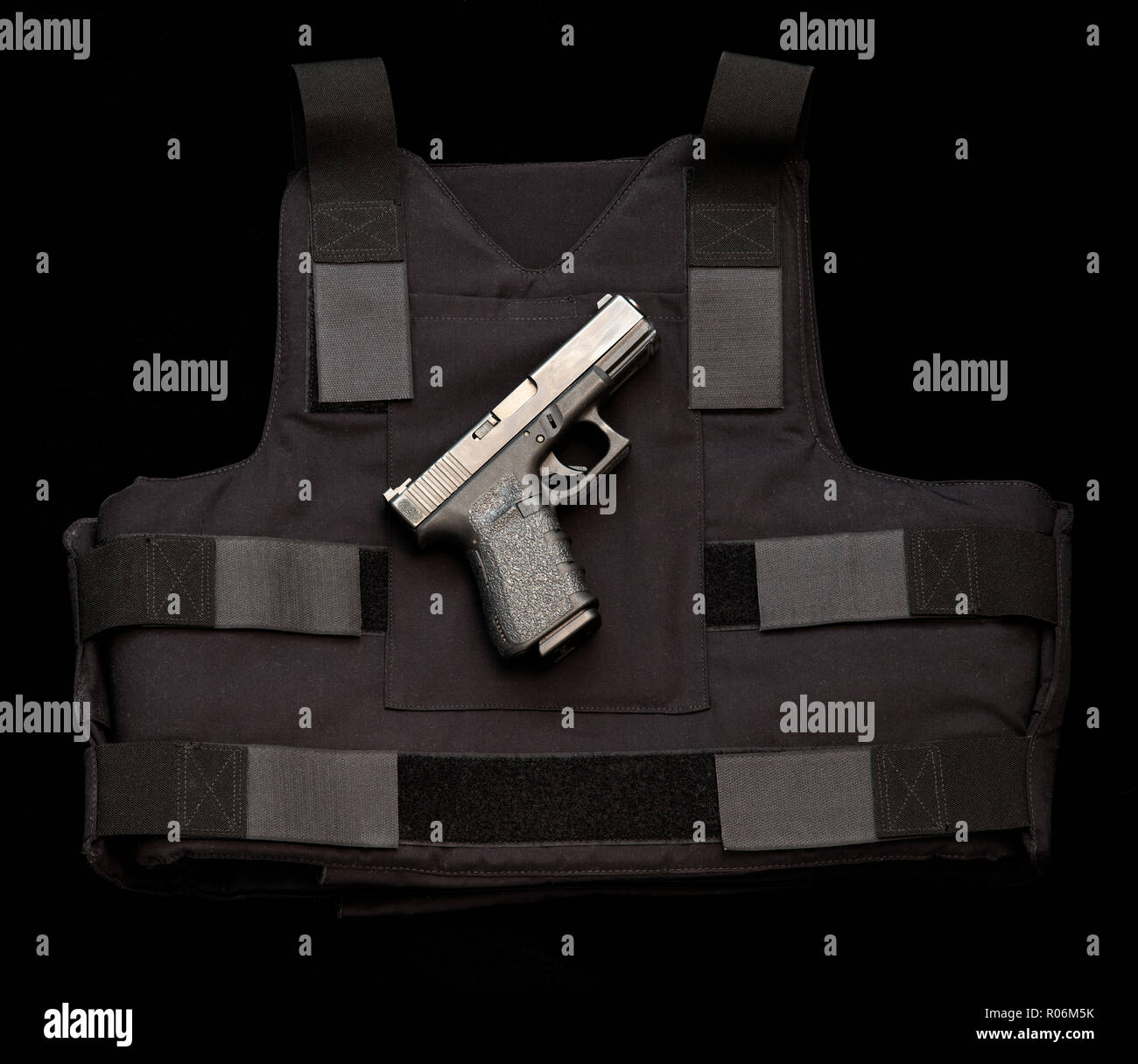 Glock semiautomatic pistol and bulletproof vest. Stock Photo