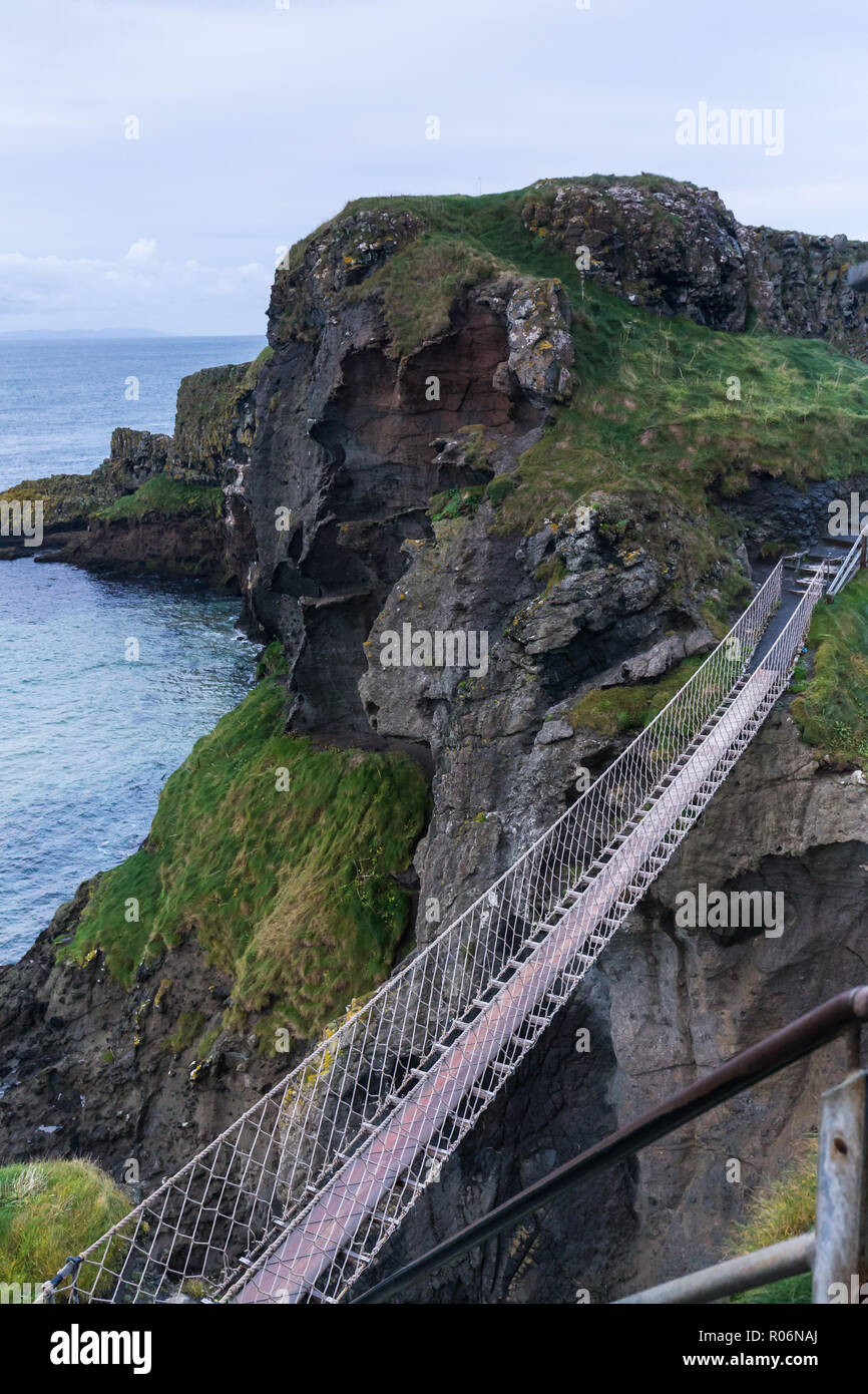 Early morning view of empty rope bridge at Carrick-a-Rede, County Antrim, N.Ireland. - Stock Image