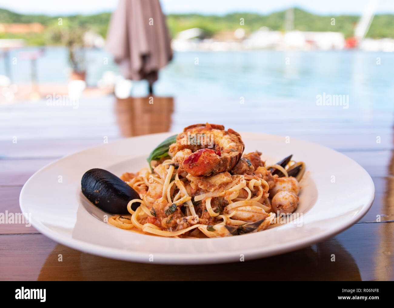 Seafood Pasta in white bowl on wooden ...