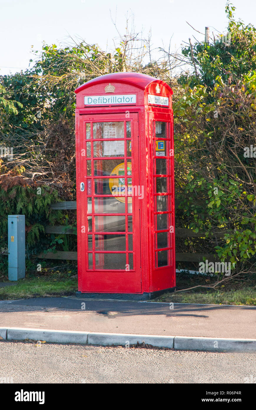 Ex Phone Box now being used to hold a Defibrillator at busy road junction. . Blackpool Lancashire England UK - Stock Image