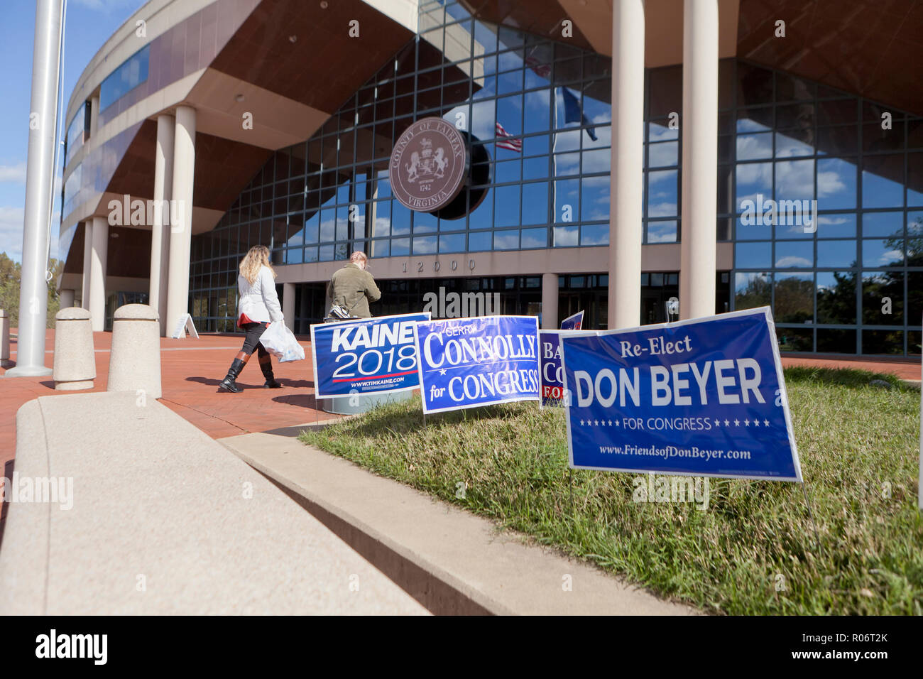 Virginia congressional race candidates placards outside of a polling place during the 2018 midterm elections - Fairfax County, Virginia USA - Stock Image