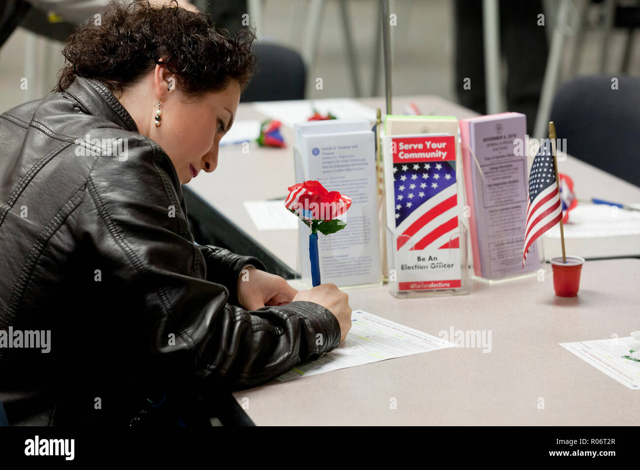 Woman fills out absentee vote application during 2018 midterm elections - Fairfax County, Virginia USA - Stock Image