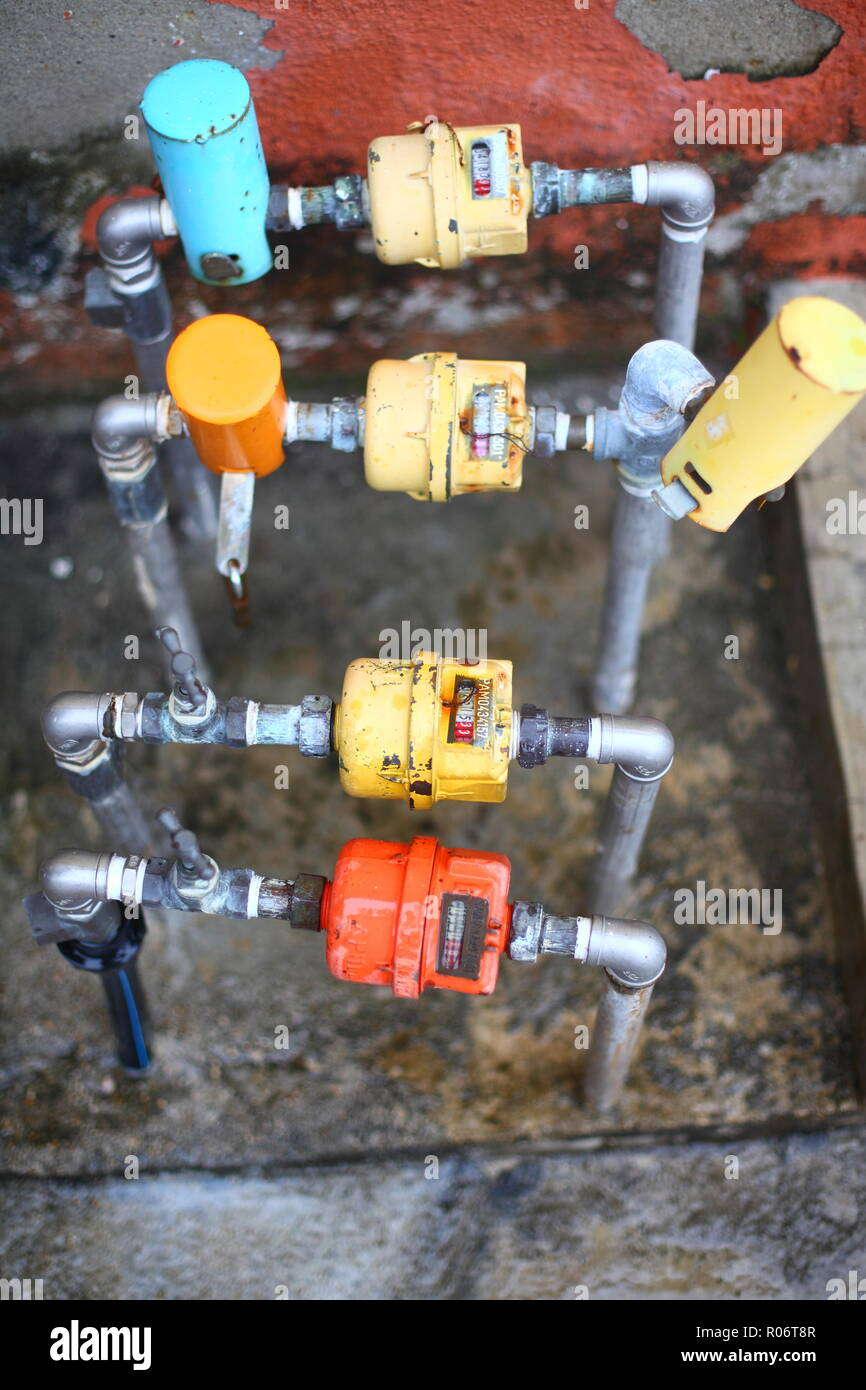 Picture of a water meter/displacement meter installed on the ground. - Stock Image