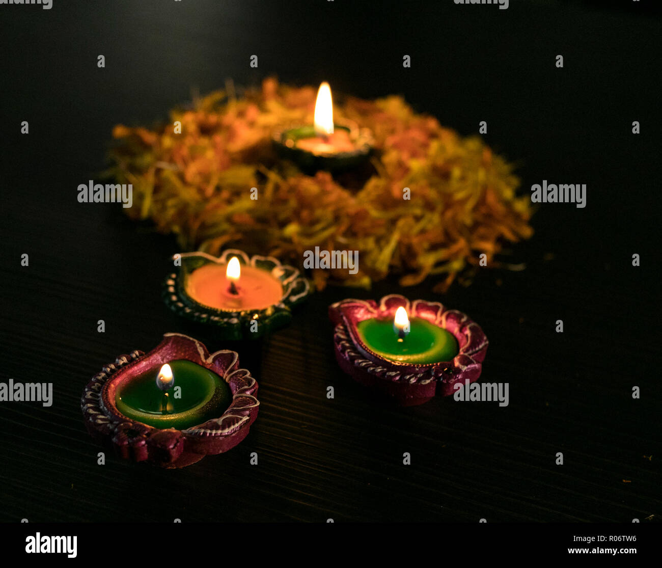 Colourful diya arranged in diffrent ways to celebrate Diwali and Dhanteras Stock Photo