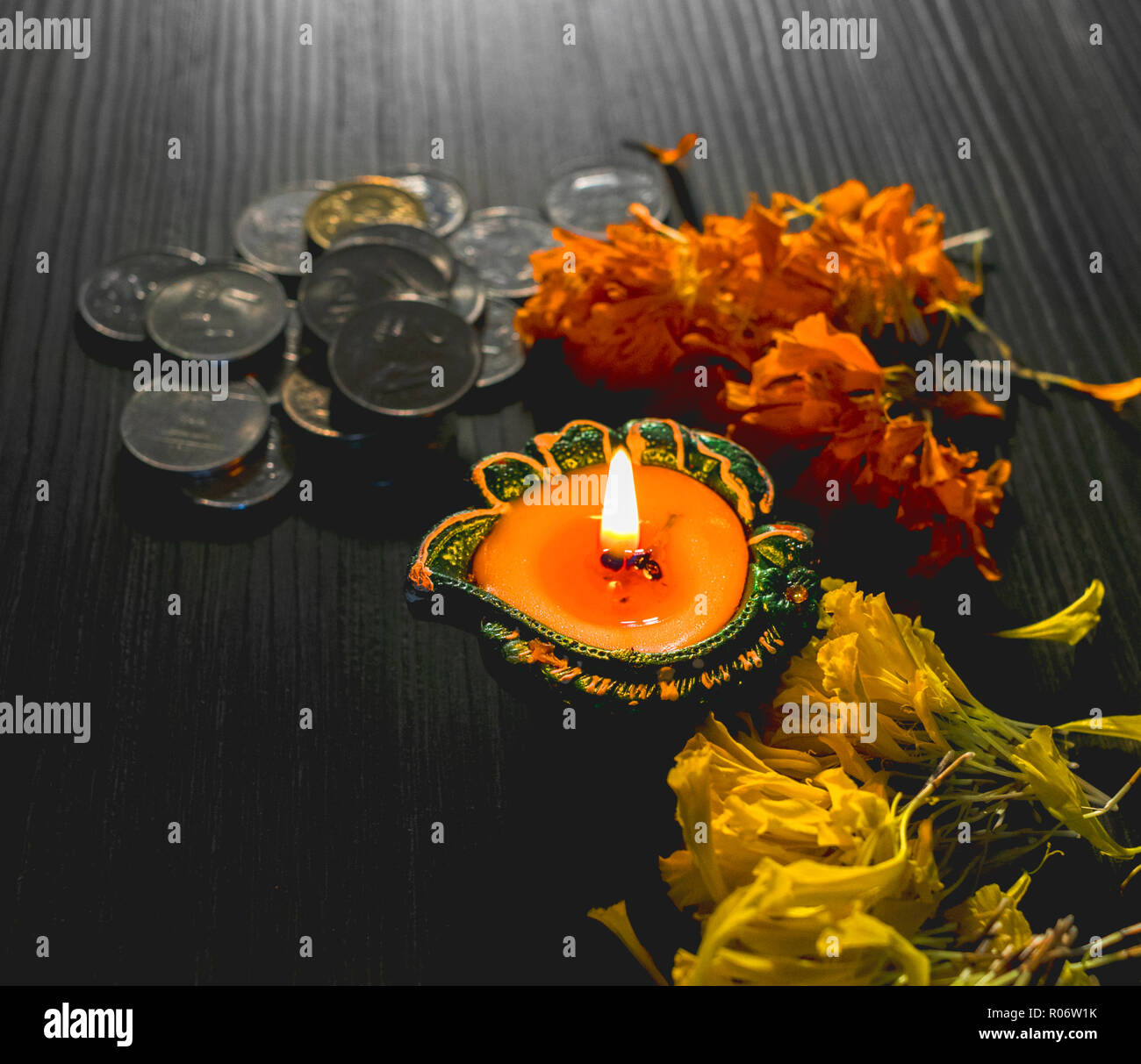 Isolated lit diya/lamp for the celebration of Diwali and Dhanteras Stock Photo