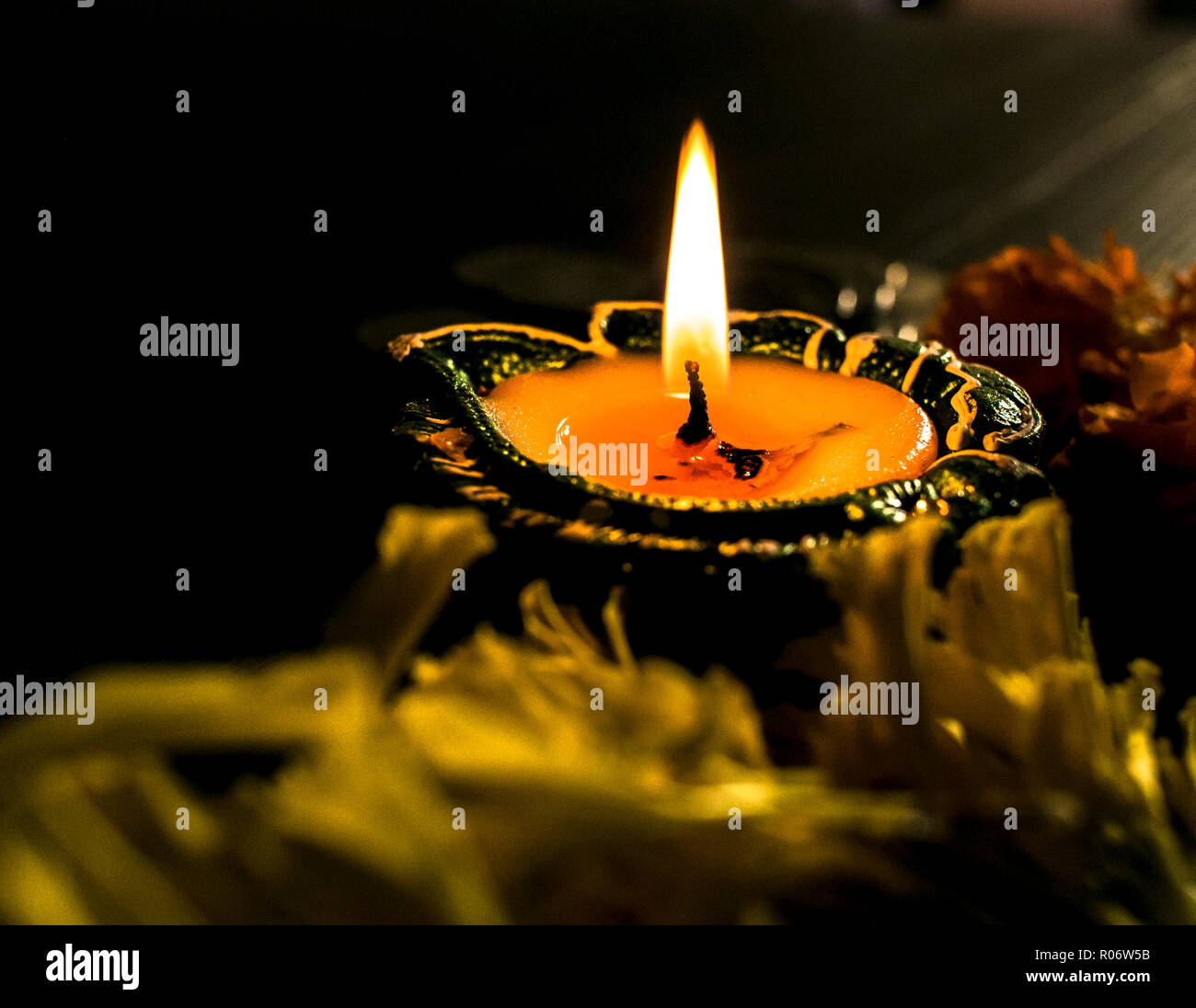 Isolated diya/lamp placed on table Stock Photo