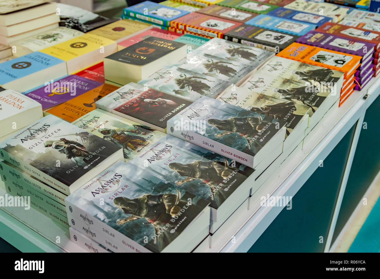 Eskisehir, Turkey - October 09, 2018: Several Assassin's Creed books exhibited on the stand at Eskisehir Book Fair - Stock Image