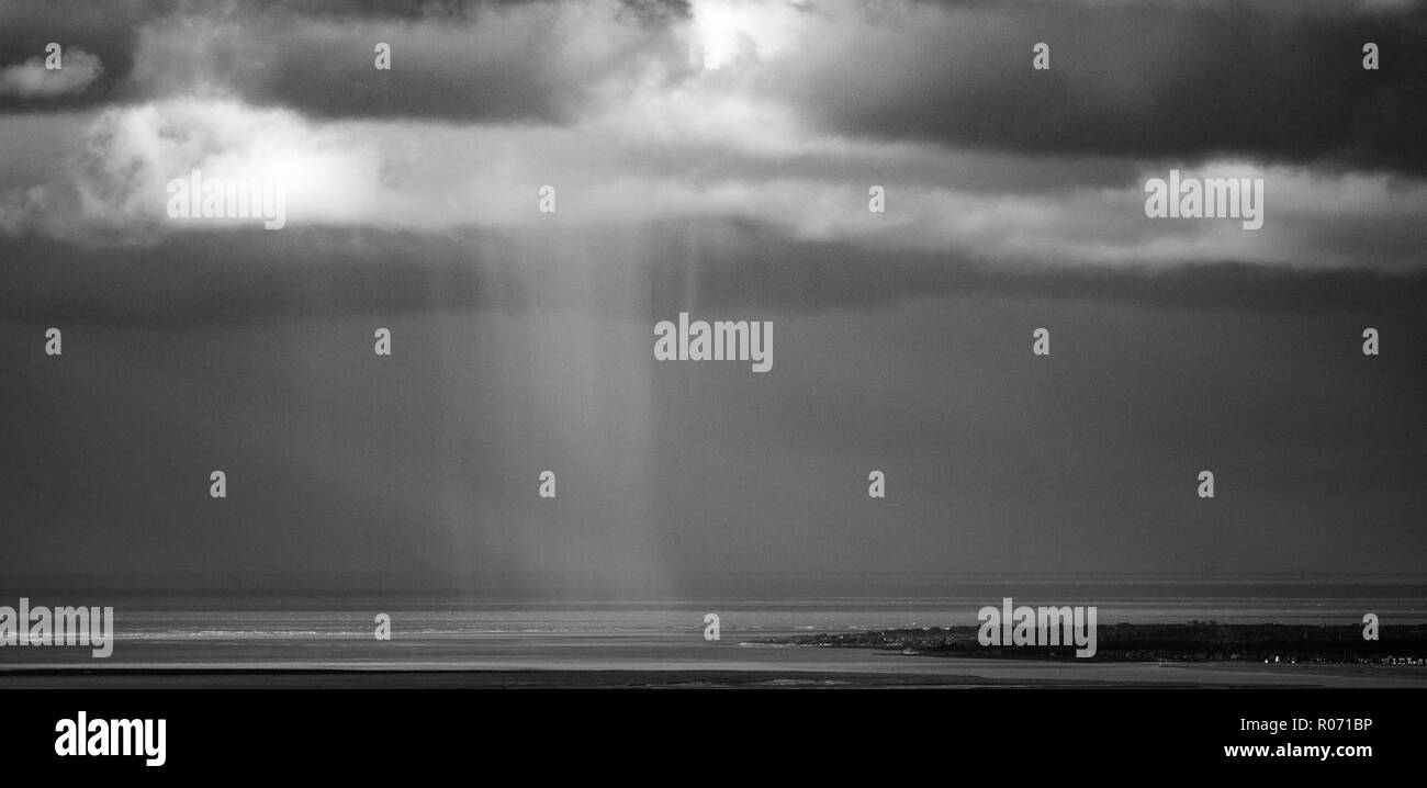 Atmospheric squall in black and white over the sea and the Ribble Estuary - Stock Image