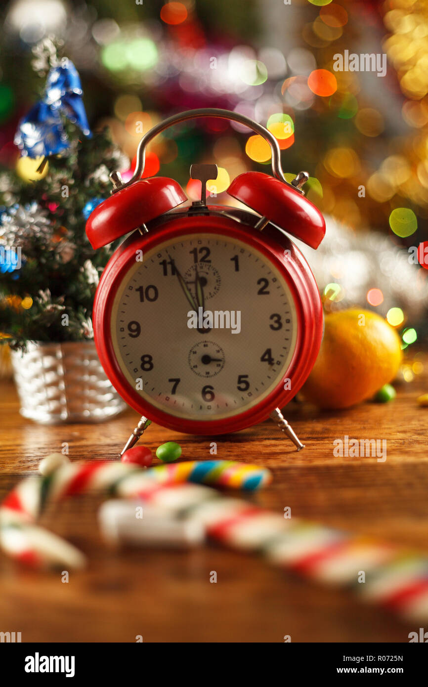 Vintage alarm clock in the New Year's setting from five to