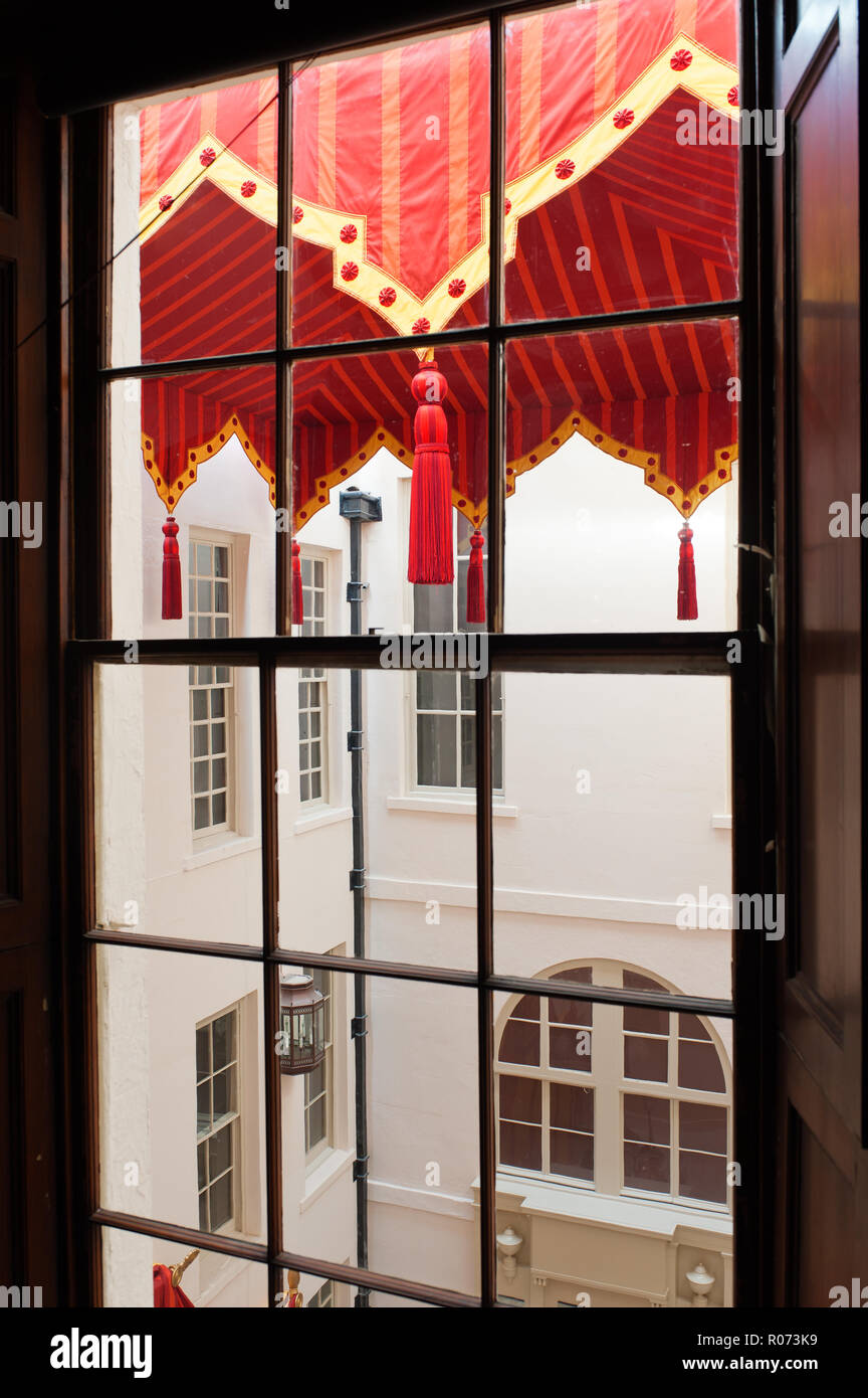View through window to awning in courtyard - Stock Image