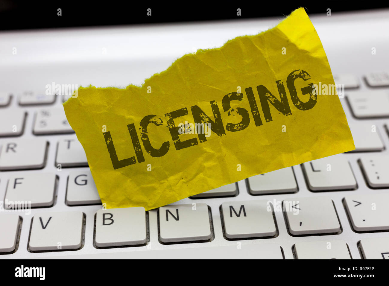 Text sign showing Licensing. Conceptual photo authorize the use perforanalysisce or release of something like car. - Stock Image