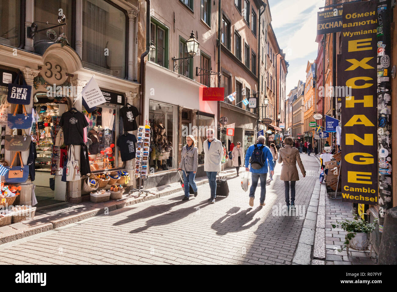 16 September 2018: Stockholm, Sweden - Tourists wandering the streets of Gamla stan, Stockholm's old town, on a sunny autumn day. Stock Photo