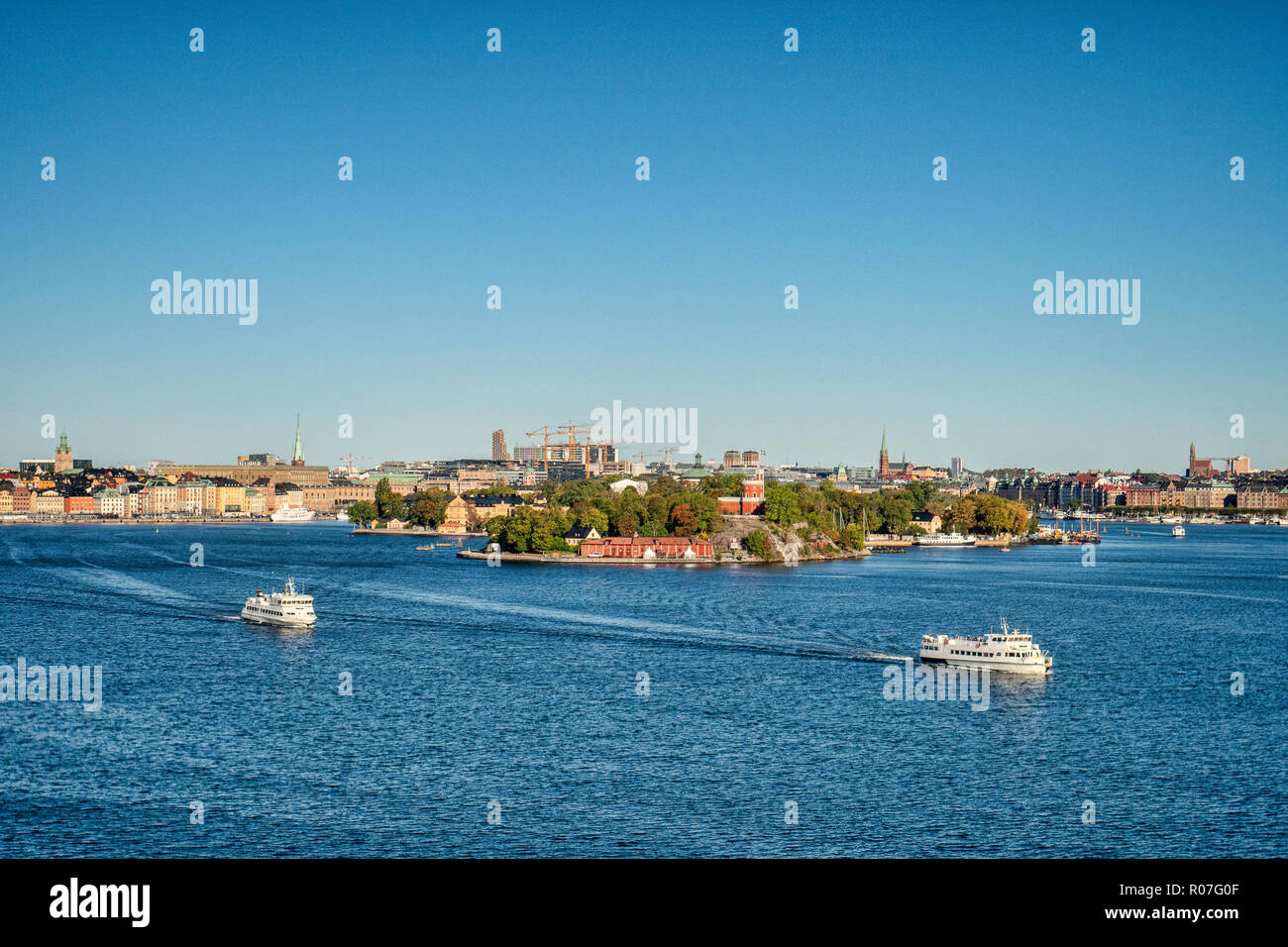16 September 2018: Stockholm, Sweden - Ferries in Stockholm Harbour, seen from the deck of a cruise liner. - Stock Image