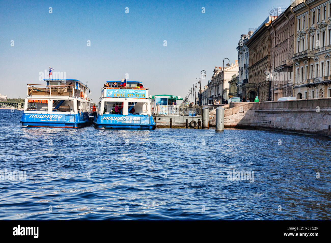 19 September 2018: St Petersburg, Russia - Tour boats in the River Neva, on a bright autumn day with clear blue sky. - Stock Image