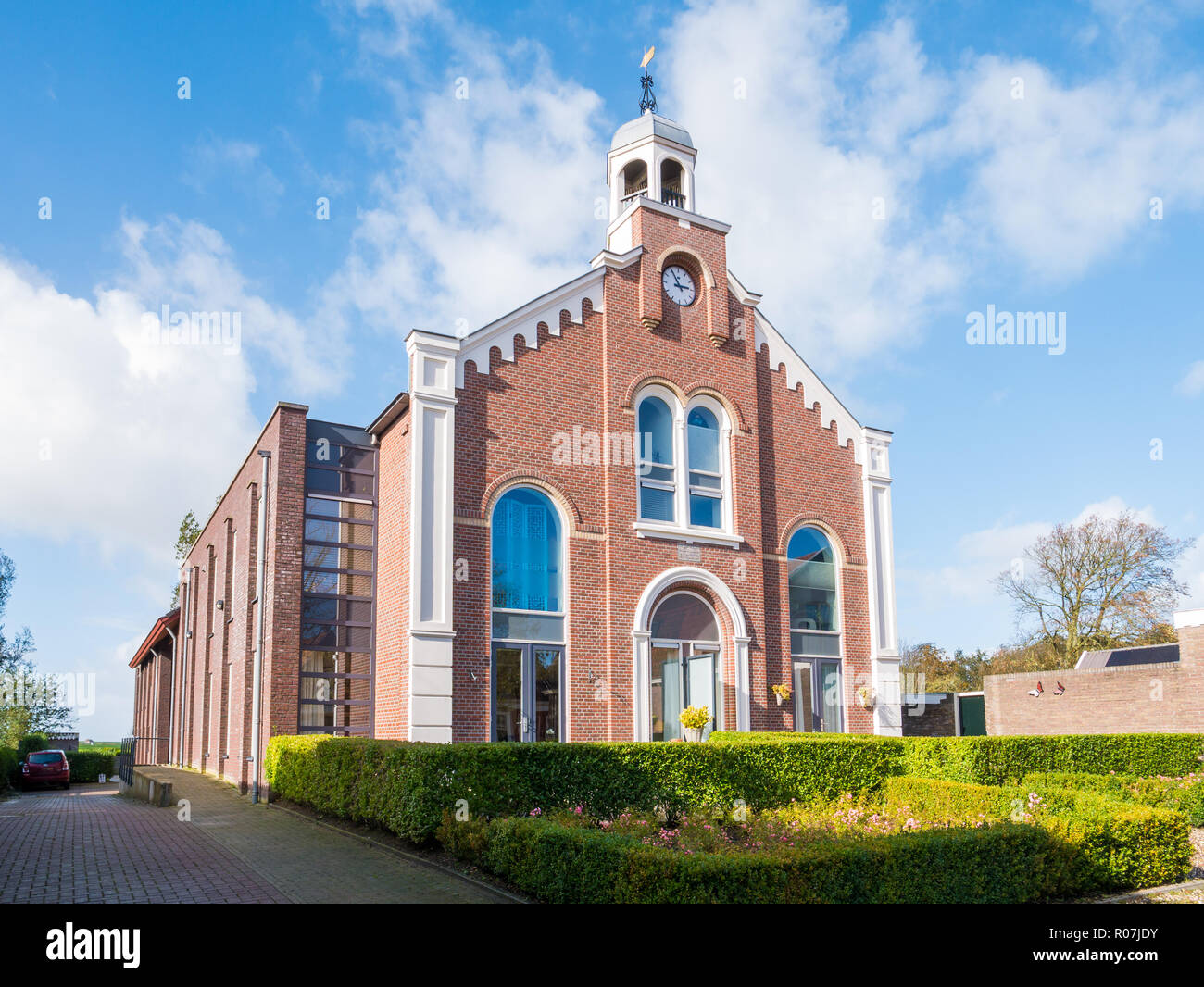 Former church building now apartment building in downtown Workum, Friesland, Netherlands Stock Photo