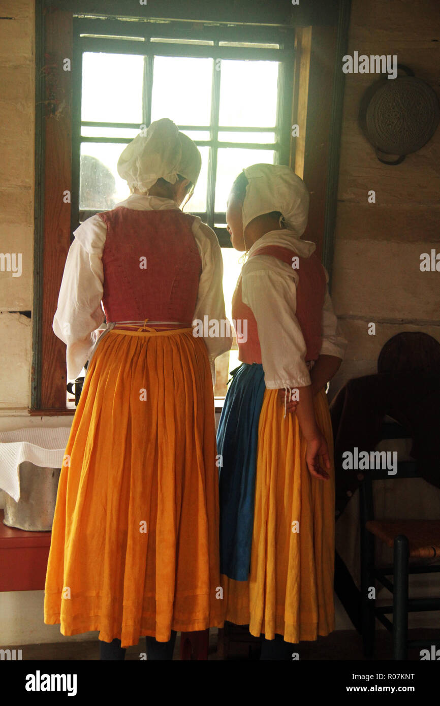 Young girls reeancting at Frontier Culture Museum in Staunton, VA. 19th century-style clothing. - Stock Image