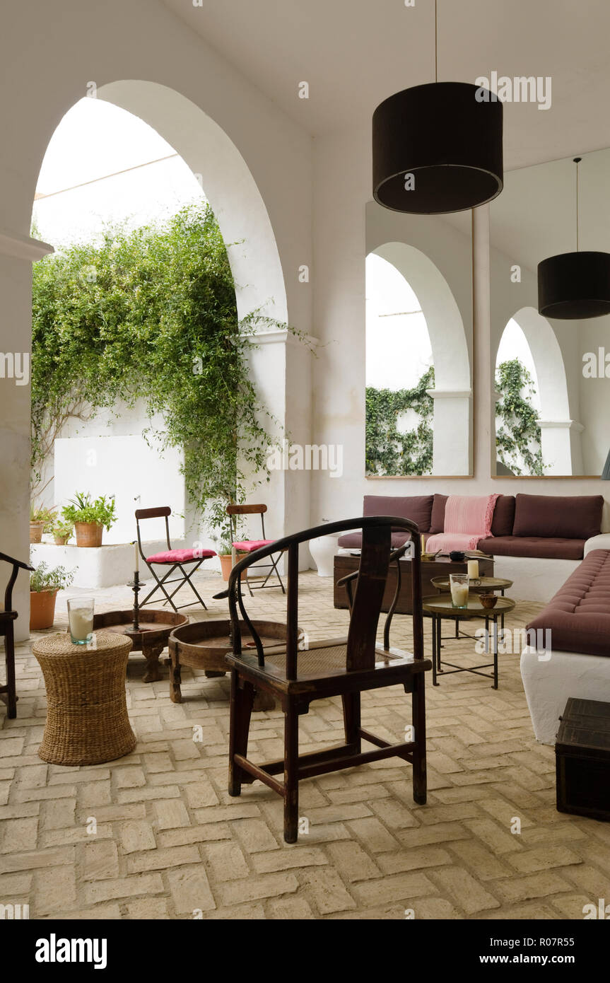 Sofa and chairs in Mediterranean courtyard - Stock Image
