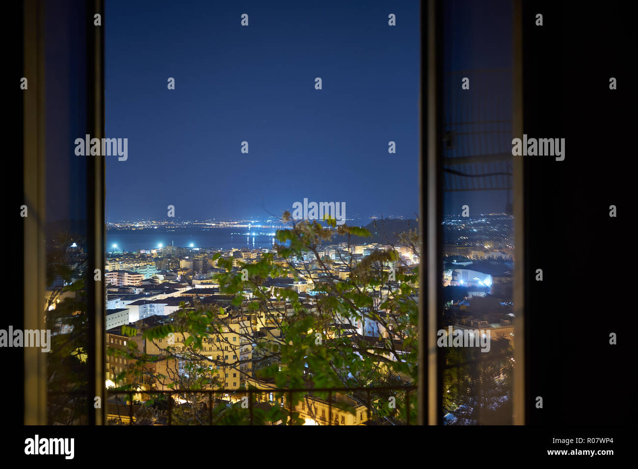 nightscape panorama from an open window - Stock Image
