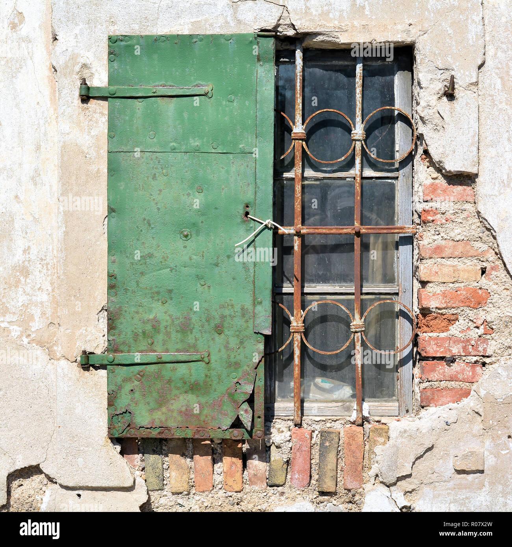 Shutter in a village in Slovenia - Stock Image